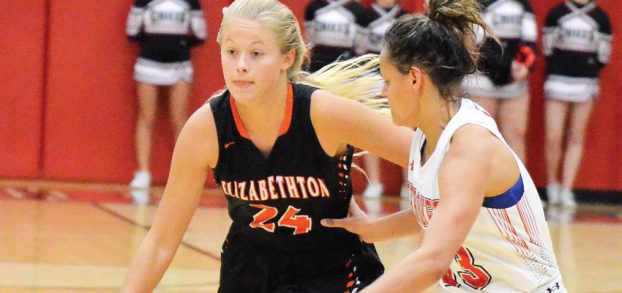 Star Photo/Ivan Sanders Kaylen Shell of Elizabethton brings the ball into the front court while being guarded by Mataylin Goins.