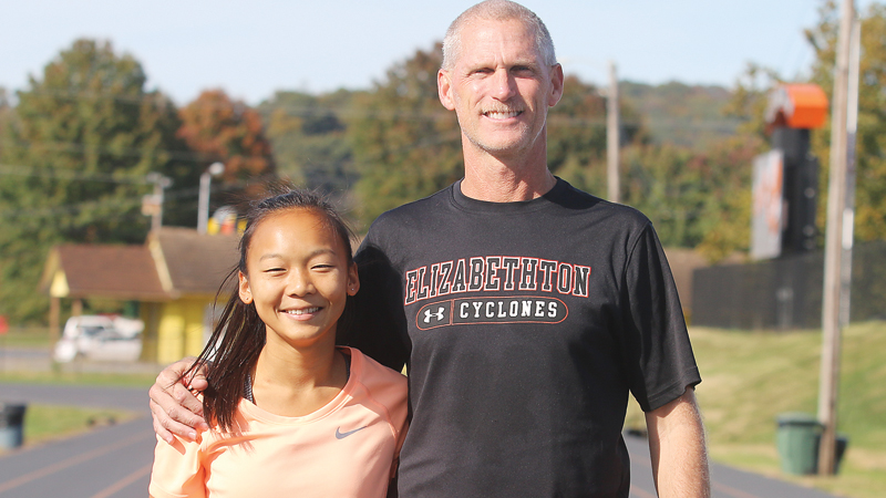 Star Photo/Bryce Phillips Elizabethton senior Lauren Pilkton will compete in the TSSAA State Large Schools Meet this Satruday at the Percy Warner Park in Nashville. Pilkton, left, is picuted with EHS cross country coach Mark Newman.
