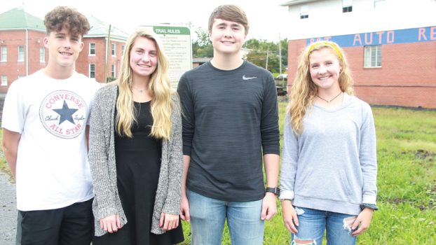Star Photo/Curtis Carden Elizabethton High School students are in the process of turning land near J's Corner into a park to serve Tweetsie Trail users. Pictured (from left) are Nick Street, Ellie Dugger, Nick Wetzel and Cami Davison