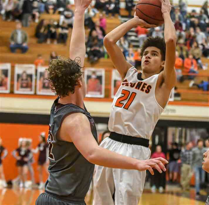 Elizabethton's Nico Ashley goes up for a jumper over Happy Valley's Bryce Carter in Friday's game.