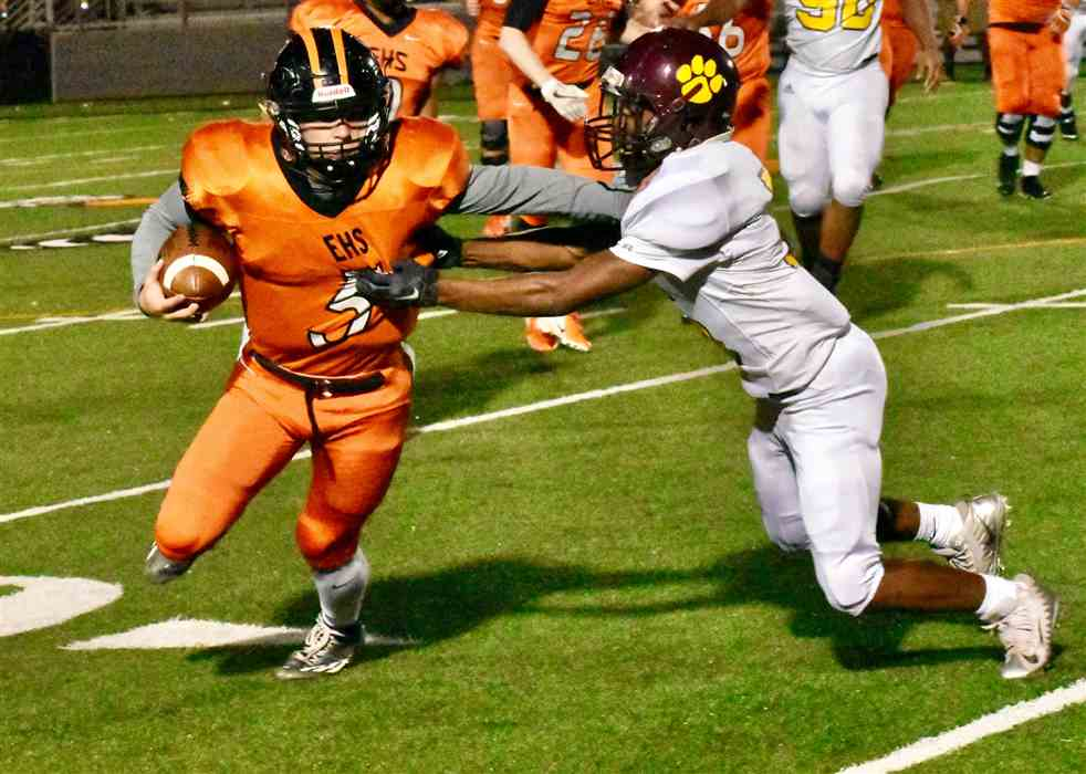Elizabethton's Corey Russell applies a stiff arm to Howard's Trevon Crutcher after a pass reception in Friday's game.