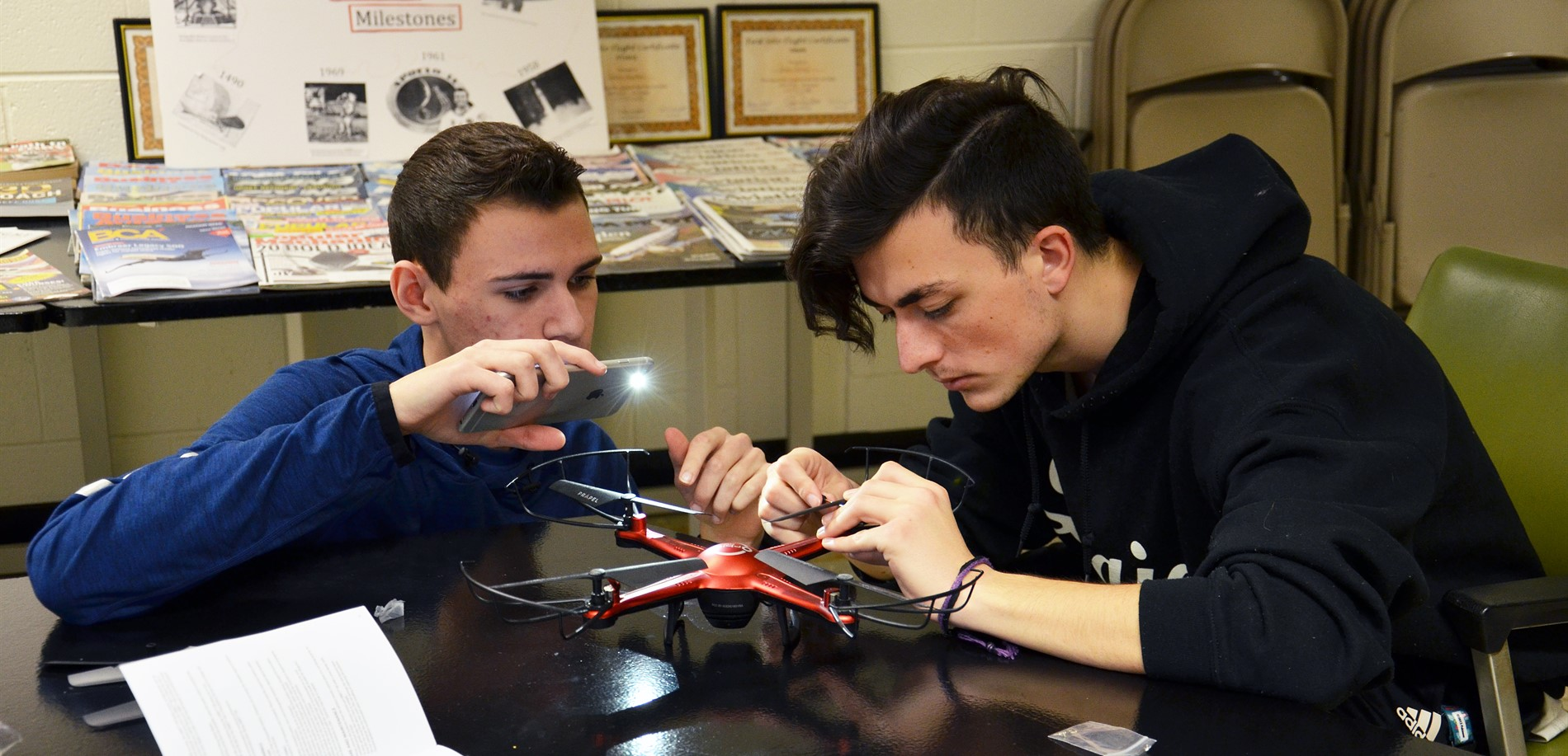 Students working on a drone
